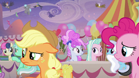 Applejack looks leery at Big McIntosh S9E26