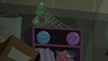 Bowling balls falling off the shelf S5E6.png