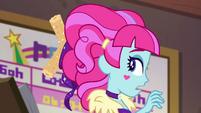 Kiwi Lollipop with a churro in her hair EGSBP