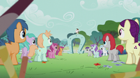 Other students hear Pip speaking on a giant horseshoe S5E18
