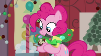 Pinkie looking at stuff in her hooves BGES2