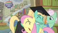 Zephyr the graduate and Fluttershy hugging S6E11