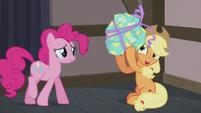Applejack shaking Pinkie's present S5E20