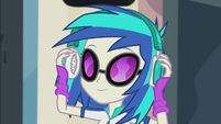 DJ Pon-3 putting on headphones EG2