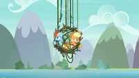 Dash and AJ in hanging cage of vines and branches S8E9