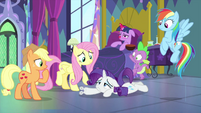 Rarity lying on Twilight's bedroom floor MLPS2