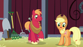 Applejack notices her cutie mark glowing S5E17.png