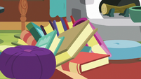 Books topple on top of Angel S7E5