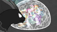 Pony of Shadows stands over the shielded ponies S7E26