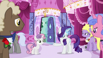 Rarity opens the boutique's front door S6E14