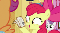 Apple Bloom holding the train tickets S9E22