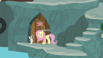Fluttershy and Angel outside supply room S9E18
