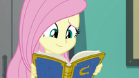 Fluttershy smiling at the yearbook EGFF