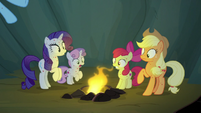 Rainbow Dash tosses a campfire into the cave S7E16