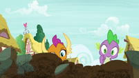 Spike and Smolder look at the crater S8E24