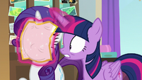 Twilight shoves a flyer in Rarity's face S8E16
