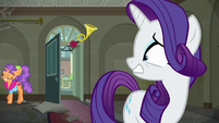 Rarity looks mortified as Plaid Stripes walks away S6E9
