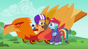 Scootaloo in a phoenix-themed cart S6E14