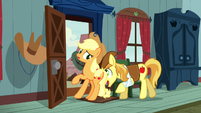 Braeburn pushing Applejack out the door S5E6