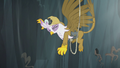 Gilda grabs onto the rock wall with her claws S5E8.png
