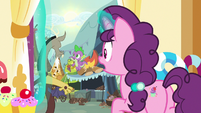 Sugar Belle sees Spike and Discord outside S9E23