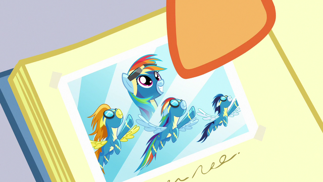 File:Close-up on photo of Rainbow as official Wonderbolt S7E7.png