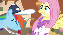 Fluttershy startled by Rainbow's whistling S02E22