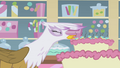 Gilda blowing out cake candles S1E05.png