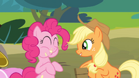 Pinkie eating an apple while Applejack is singing S4E09
