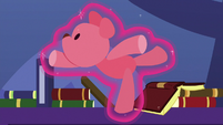 Red teddy bear floats gracefully through the air S7E3