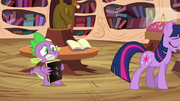 Spike holding Star Swirl's book S03E13