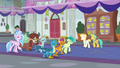 Students walk through the hall exhausted S8E1.png
