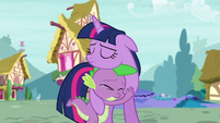A teary-eyed Spike hugging a sad Twilight S5E3