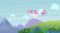 Adult Sweetie Belle flying over prairies S9E22