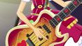 Applejack strumming her bass guitar EG4.png
