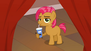 Babs Seed drinks out of a movie character S3E4