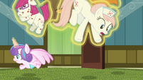 Flurry Heart levitates Redheart into the air S7E3