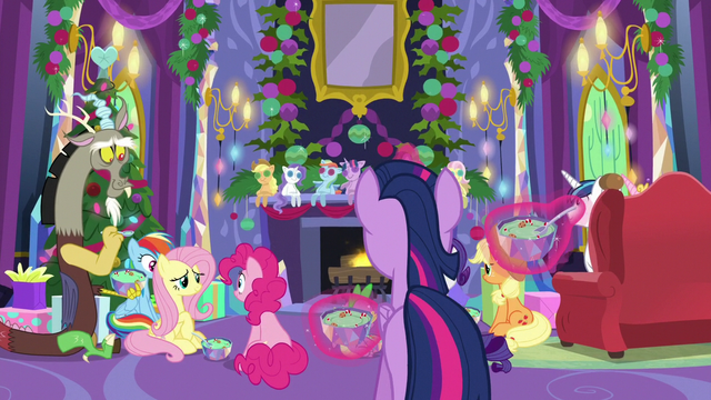 File:Ponies eating pudding around the fireplace MLPBGE.png