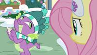 Spike smiling giddily at Fluttershy MLPBGE