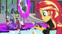 Sunset Shimmer looking at the device EG3