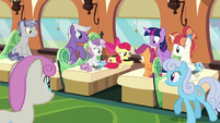 Train passengers listening to Apple Bloom S8E6