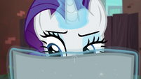 Rarity still reading the flyer S5E16