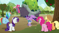 Twilight brings Spike safely to the ground S9E13