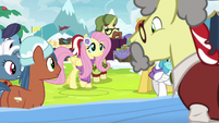 Fluttershy approaching Flim's stand MLPBGE
