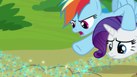 Rainbow pointing at trail of Azurantium S8E17