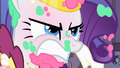 Rarity angry at Prince Blueblood for using her as a shield against the cake S1E26.png