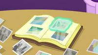 Starlight pasting a photo in the scrapbook S6E21
