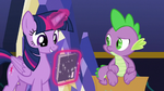 Twilight looks at Power Ponies comic S9E26
