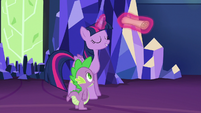 Twilight rolls up the scroll of Spike's notes S6E22