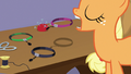 Applejack tosses purple band onto the table S7E9.png
